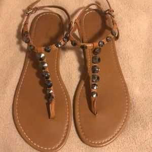 Brown American Eagle sandals.